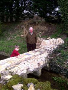 With Grandson at Restored Clapper Bridge at Signet
